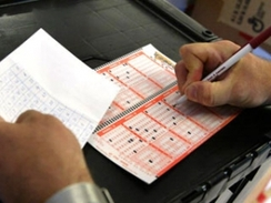 Regular lottery player choose his lotto numbers.